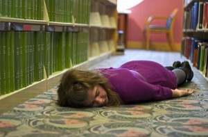 At least no one will fire you for passing out in a library.